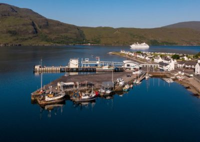 Ullapool harbour with Corrie Cottage in the background